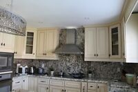 A complete 10'x10' L kitchen with 100%solid wood and granite top