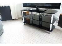 Modern glass TV stand. Sleek and very sturdy.
