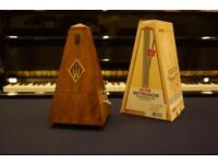Walnut matte metronome by Wittner. New in box. Can be posted.