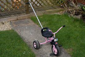 Pink Kettler Child's Trike with pedals and push bar