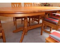 Extending Ikea pine dining table and 8 chairs with removable cushions
