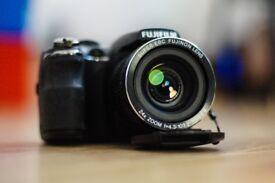 Fuji Finepix S3200. 14mp 24x zoom bridge camera. £90 ono