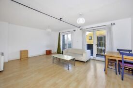 2 bedroom top floor apartment in secure development with excellent transport links to the city