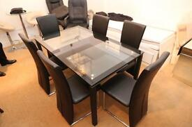 Pagazzi Glass dining table. Clear glass with black edging. Six black high-back leather chairs.