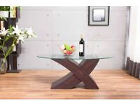 New - Oval glass top and X leg brown wood coffee table