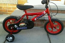 Child's first bicycle with stabilizers in excellent condition.