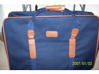 Pair of suitcases and a weekend bag