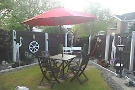 Wooden garden table and 4 chairs parasol and metal base