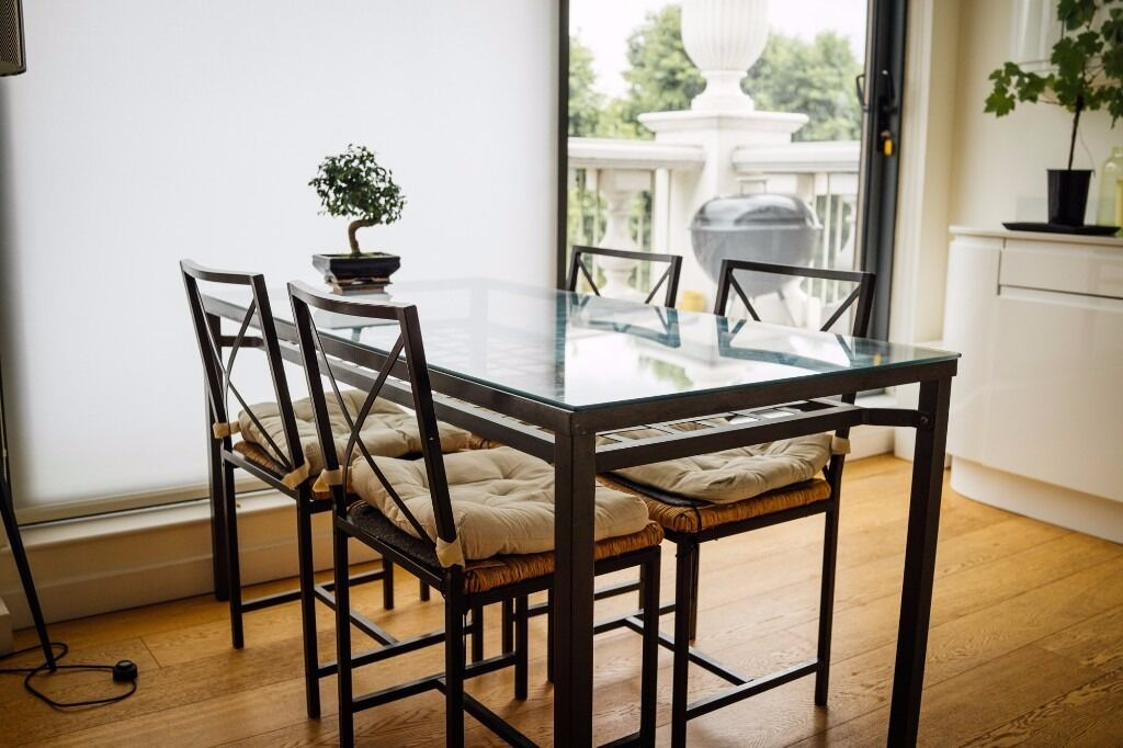 ikea granas glass table and 4 chairs in black metal with