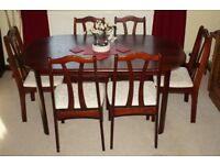 Dark Rosewood type, 6 seat dining room table and chairs
