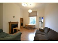 Furnished modern first floor flat comprising a bright reception with dining space in Earl Court