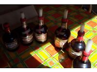 Table candles (6 vintage Drambuie bottles with candle tops) maybe a restaurant or Christmas party