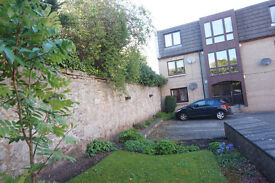 Beautiful 1 bed flat with parking. Partially furnished.