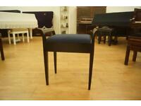 Black antique piano stool with music storage