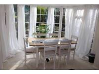 Chicago extendable solid wood dining table