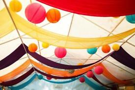 Coloured material/drapes and lanterns for wedding/marquee/festival/party