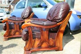 2 luxurious brown leather arm chairs solid wood