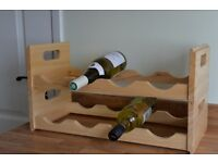 Two tier wooden wine rack, separates into two smaller ones.
