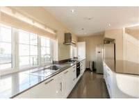 A fantastically designed 2 bedroom house with off street parking located in the heart of Hammersmith