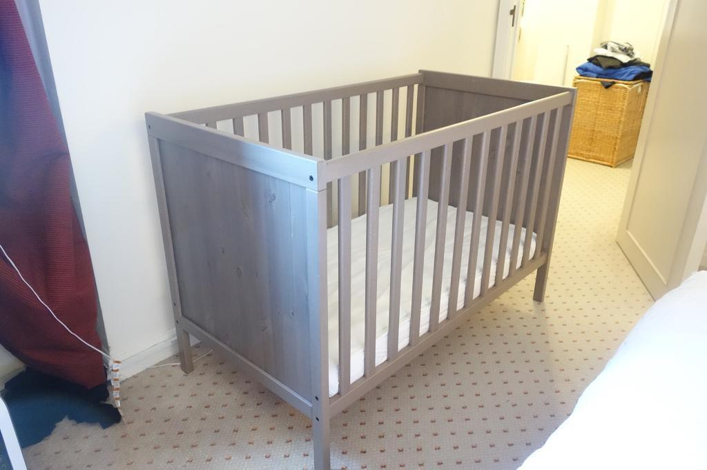 IKEA SUNDVIK adjustable height baby cot with mattress and pad