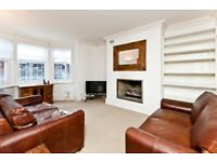 A spacious PART FURNISHED lower ground floor flat with private paved garden