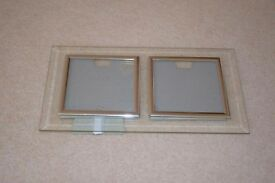 Double Photo Frame. Holds two photographs 8 1/2cm x 8 1/2 cm. Glass outside frame.