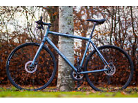 "Carrera Gryphon Hybrid Bike, 21.5"" frame, 18 speeds, DISC Brakes, fast and light bike."