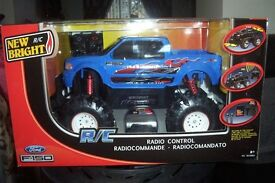 radio control truck 6v blue/red 8+ bnib approx 18in x12in.