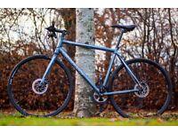 "Carrera Gryphon Hybrid Bike, 21.5"" frame, 18 speeds, DISC Brakes, fast and light bike."