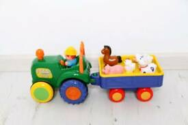 Farm tractor toy. Sound music. Boy girl unisex