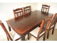 Dining table and 6 chairs - dark wood, with subtle Moroccan style decoration