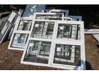 A selection of new double glazed windows and doors, some with leaded lights etc