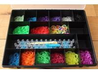 Box of loom bands and board