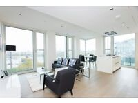 DESIGNER FURNISHED 11TH FLOOR 2 BEDROOM APARTMENT IN SOUTHBANK WITH RIVER VIEWS FACILITIES CONCIERGE