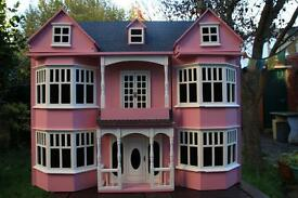 Children's/ collectable's pink doll house