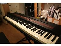ROLAND EP 77 PIANO WITH STAND FOR SALE