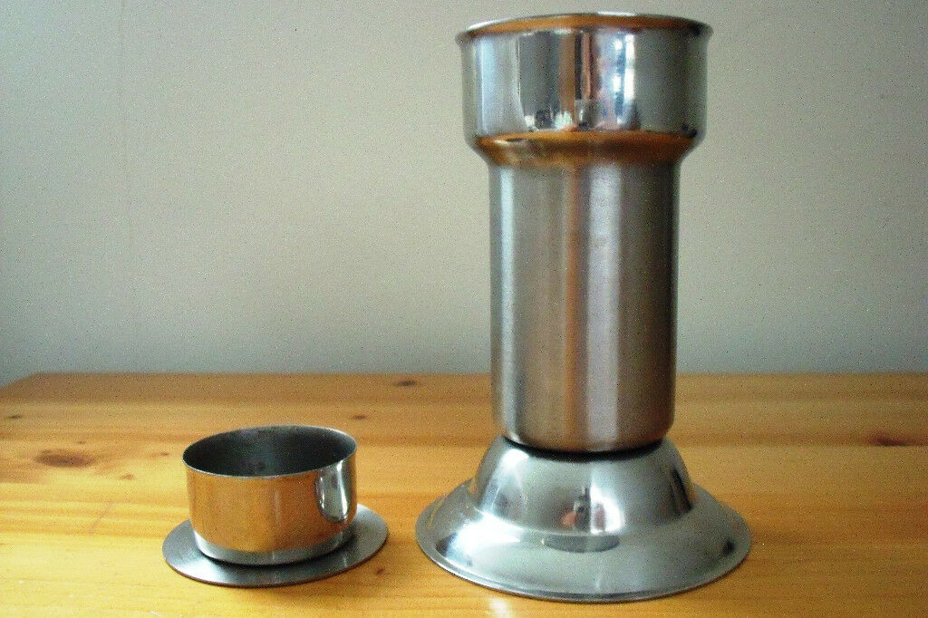 2-in-1 candlestick or tea-light holder - flip insert to use for either.Stainless Steel 18/8. £3 ovno