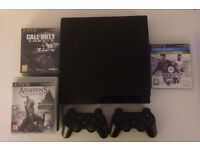 PS3 Slim 160GB - Including 2 Controllers, Cables, all Assassin Creed games for PS3, FIFA14, COD
