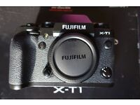 Fujifilm X-T1. Fully boxed and Immaculate condition. One month old, 600 shots. Spare battery.