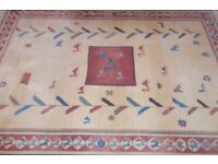 100 % wool rug Camel colour with red motif