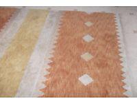 Large Kadian 100 % wool hand knotted Tibetan rug orange.fawn tan colours