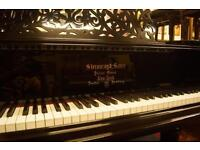 Steinway & Sons model A grand piano. Rebuilt this year with free delivery and matching concert stool