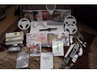 Wii console with all the bits and 11 games