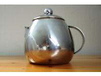 Cute, stylish, small, 1-cup, 1-person teapot. Probably stainless steel, but unmarked.