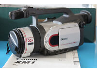 Canon XM1 Camcorder with loads of tape stock.