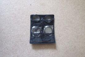 Polaroid 4-piece close up camera lens filter kit.