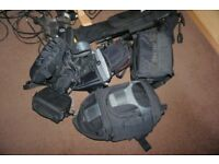 Various camera bags tripods reflectors backgrounds