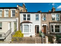 Victorian maisonette with many period features and the latest modern technology and private garden.