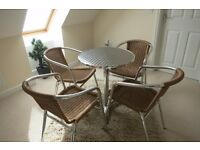 Bistro table and four wicker chairs