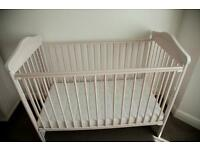 Cot bed with mattress and changing station with drawer and cupboard